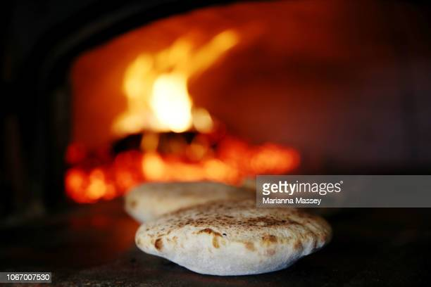 Pita bread cooked in a wood fired oven