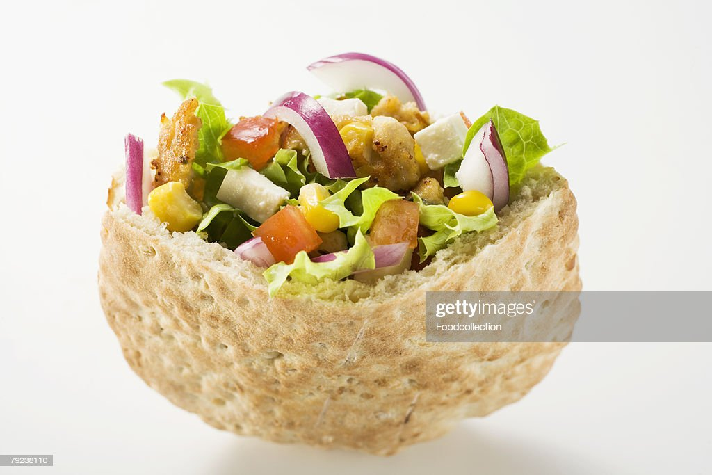 Pita bread filled with vegetables and roast turkey breast : Stock Photo