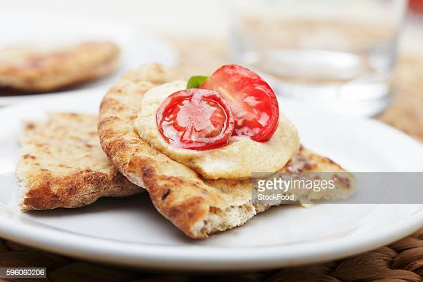Pita Bread Topped with Hummus and Cherry Tomato