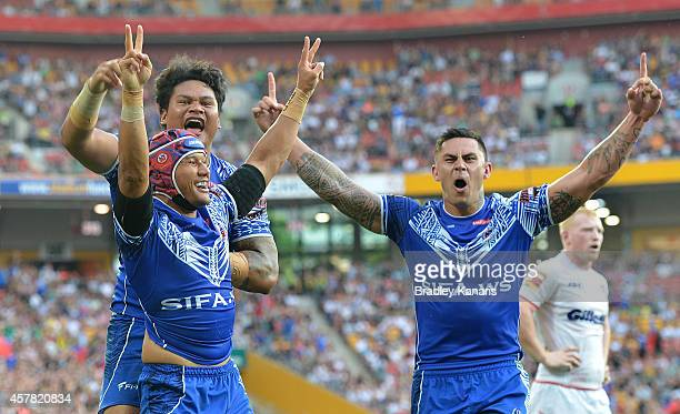 Pita Godinet of Samoa celebrates scoring a try with team mates during the Four Nations match between England and Samoa at Suncorp Stadium on October...