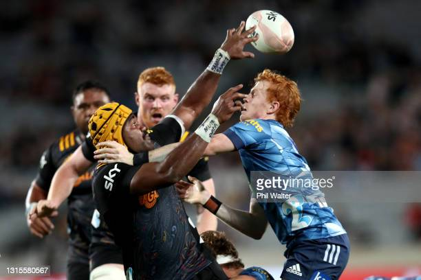 Pita Gus Sowakula of the Chiefs is tackled by Finlay Christie of the Blues during the round 10 Super Rugby Aotearoa match between the Blues and the...