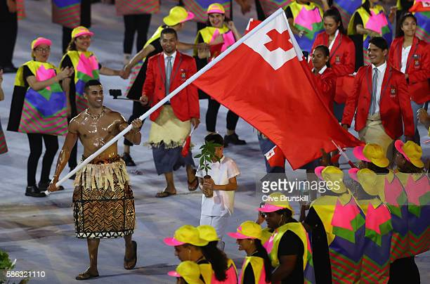Pita Nikolas Aufatofua of Tonga carries the flag during the Opening Ceremony of the Rio 2016 Olympic Games at Maracana Stadium on August 5 2016 in...