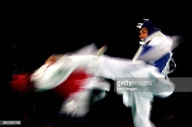 Pita Nikolas Taufatofua of Tonga competes against Sejjad Mardani of Iran during Men's 80kg Taekwondo competition at the Rio 2016 Olympic Games on...