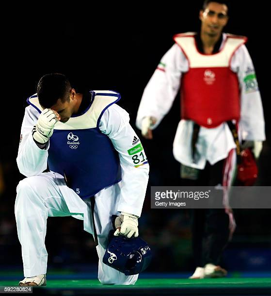 Pita Nikolas Taufatofua of Tonga reacts after being defeated by Sejjad Mardani of Iran during Men's 80kg Taekwondo competition at the Rio 2016...