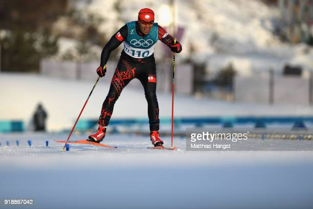 Pita Taufatofua of Tonga approaches the finish line during the CrossCountry Skiing Men's 15km Free at Alpensia CrossCountry Centre on February 16...
