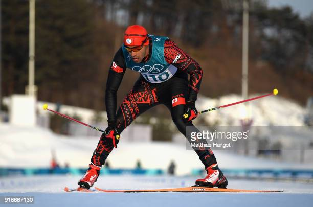 Pita Taufatofua of Tonga crosses the finish line during the CrossCountry Skiing Men's 15km Free at Alpensia CrossCountry Centre on February 16 2018...