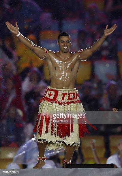 Pita Taufatofua of Tonga jumps on stage during the Closing Ceremony on Day 16 of the Rio 2016 Olympic Games at Maracana Stadium on August 21 2016 in...