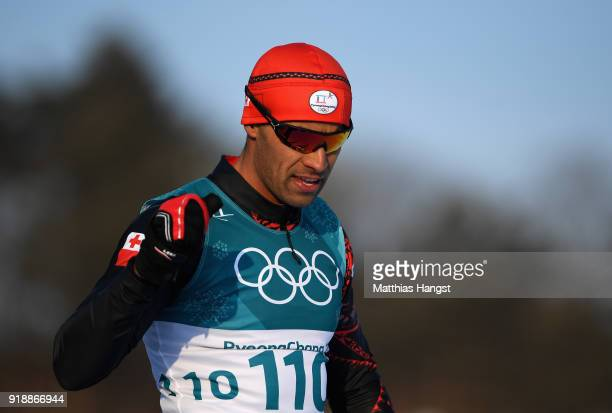 Pita Taufatofua of Tonga reacts after crossing the finish line during the CrossCountry Skiing Men's 15km Free at Alpensia CrossCountry Centre on...