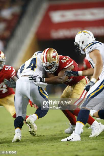 Pita Taumoepenu of the San Francisco 49ers tackles Andre Williams of the Los Angeles Chargers during the game at Levi's Stadium on August 31 2017 in...