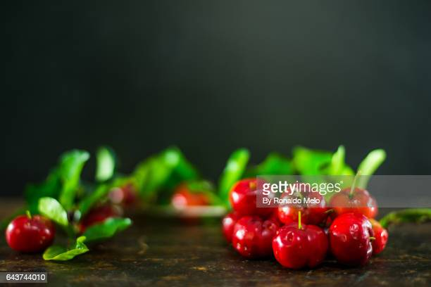 pitangas on a wooden table - belo horizonte stock pictures, royalty-free photos & images