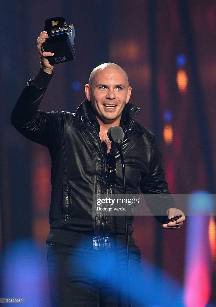 Pitbull accepts an award onstage during the Premios Juventud 2014 at The BankUnited Center on July 17, 2014 in Coral Gables, Florida.