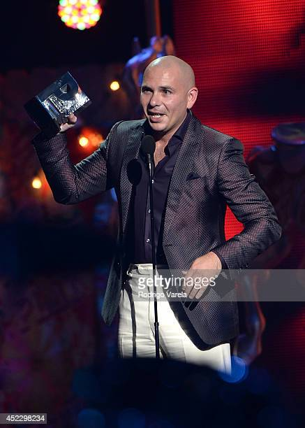 Pitbull accepts award onstage during the Premios Juventud 2014 at The BankUnited Center on July 17 2014 in Coral Gables Florida