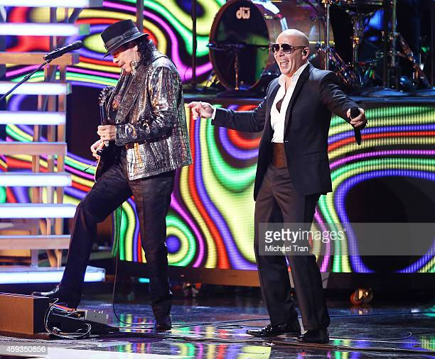 Pitbull and Carlos Santana perform onstage during the 15th Annual Latin GRAMMY Awards held at the MGM Grand Arena on November 20 2014 in Las Vegas...