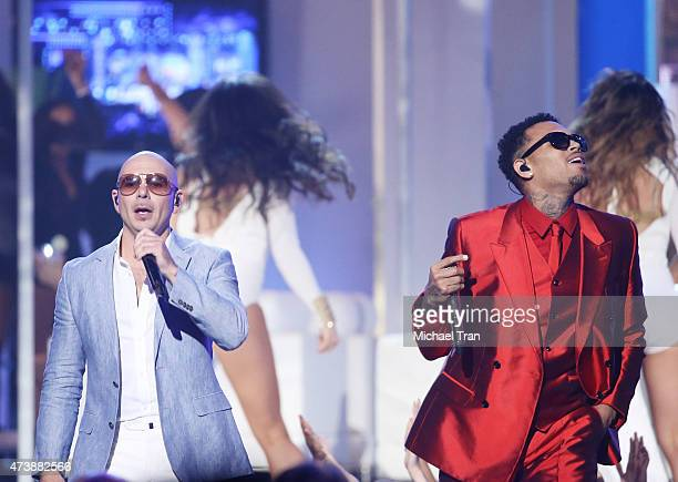 Pitbull and Chris Brown perform onstage during the 2015 Billboard Music Awards held at the MGM Grand Garden Arena on May 17 2015 in Las Vegas Nevada
