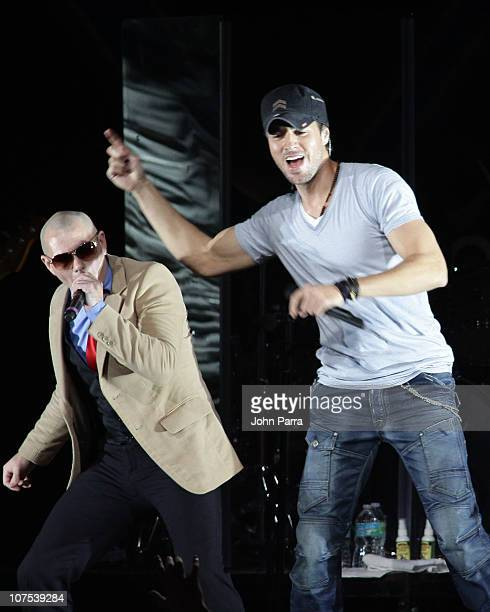 Pitbull and Enrique Iglesias perform during the Y100 Jingle Ball at BankAtlantic Center on December 11 2010 in Sunrise Florida