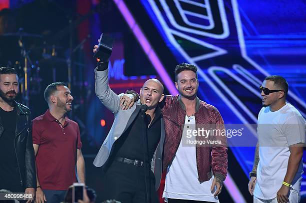 Pitbull and J Balvin accept an award onstage at Univision's Premios Juventud 2015 at Bank United Center on July 16 2015 in Miami Florida