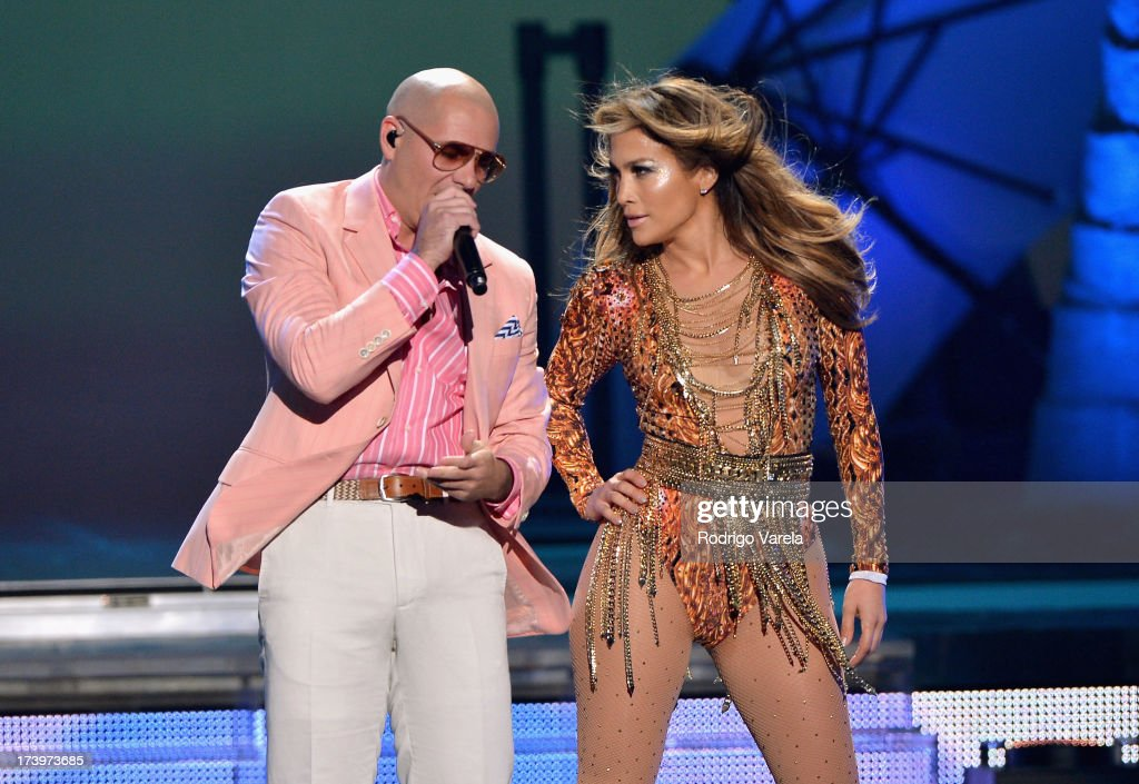 Pitbull and Jennifer Lopez perform onstage during the Premios Juventud 2013 at Bank United Center on July 18, 2013 in Miami, Florida.