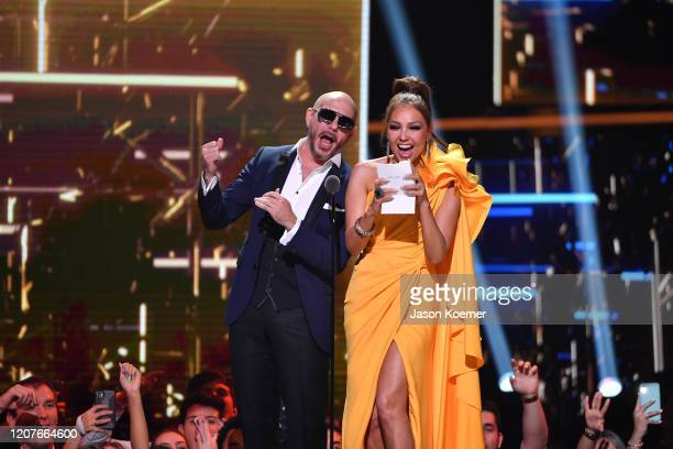 Pitbull and Thalia on stage during Univision's Premio Lo Nuestro 2020 at AmericanAirlines Arena on February 20 2020 in Miami Florida