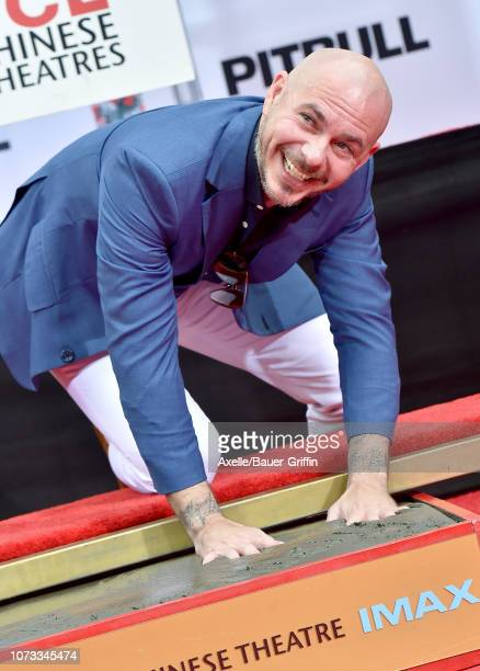 Pitbull is honored with Hand and Footprint Ceremony at TCL Chinese Theatre on December 14 2018 in Hollywood California