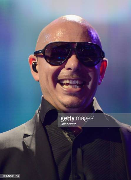 Pitbull performs at DIRECTV'S 7th Annual Celebrity Beach Bowl at DTV SuperFan Stadium at Mardi Gras World on February 2 2013 in New Orleans Louisiana