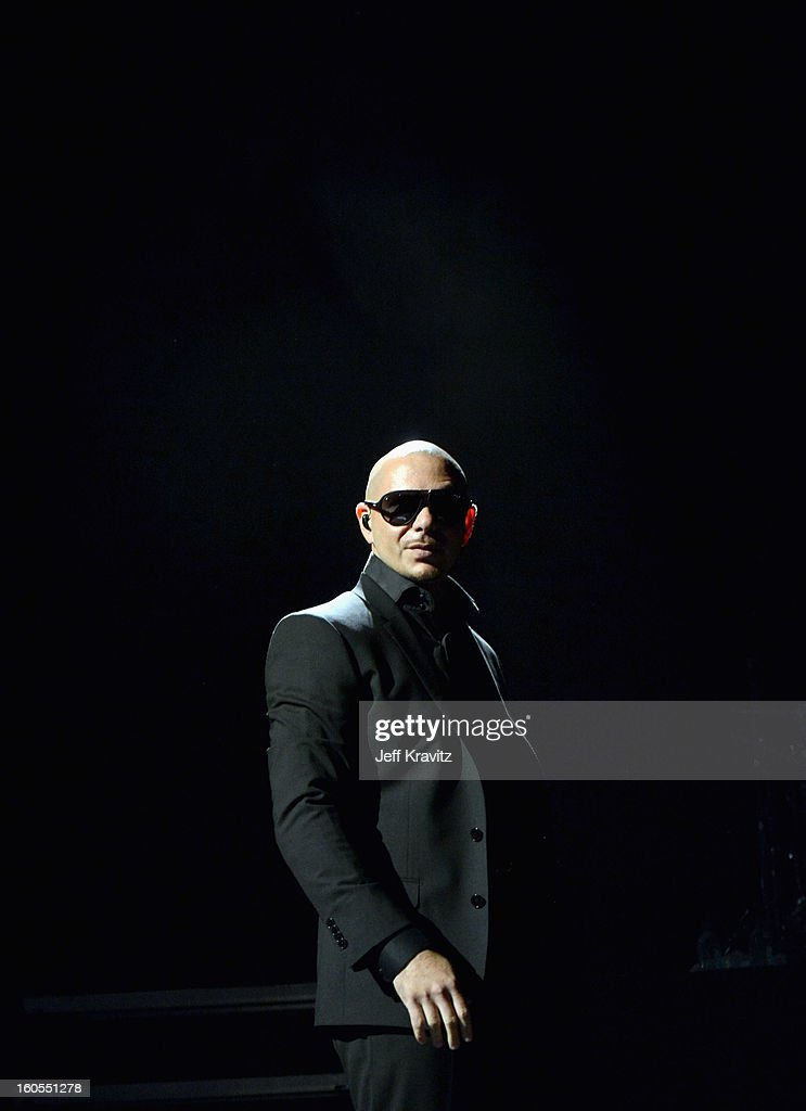 Pitbull performs at DIRECTV'S 7th Annual Celebrity Beach Bowl at DTV SuperFan Stadium at Mardi Gras World on February 2, 2013 in New Orleans, Louisiana.