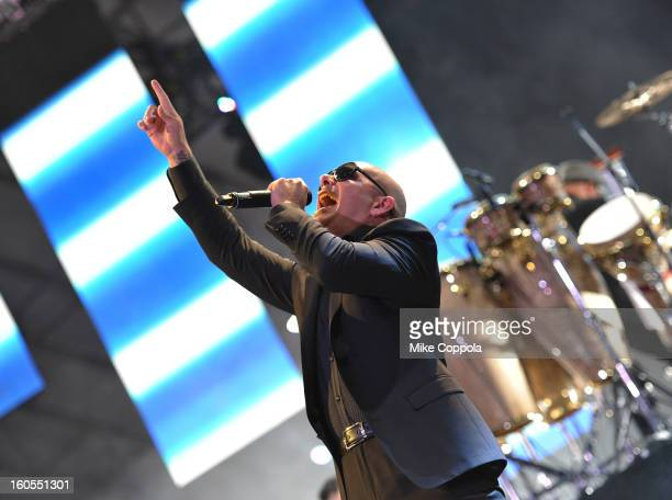 PitBull performs at DIRECTV'S Seventh Annual Celebrity Beach Bowl at DTV SuperFan Stadium at Mardi Gras World on February 2 2013 in New Orleans...