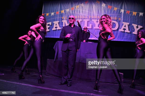 Pitbull performs during T.J. Martell Foundation's 15th Annual Family Day Honoring Tom Corson, President & COO of RCA Records and his Family at...