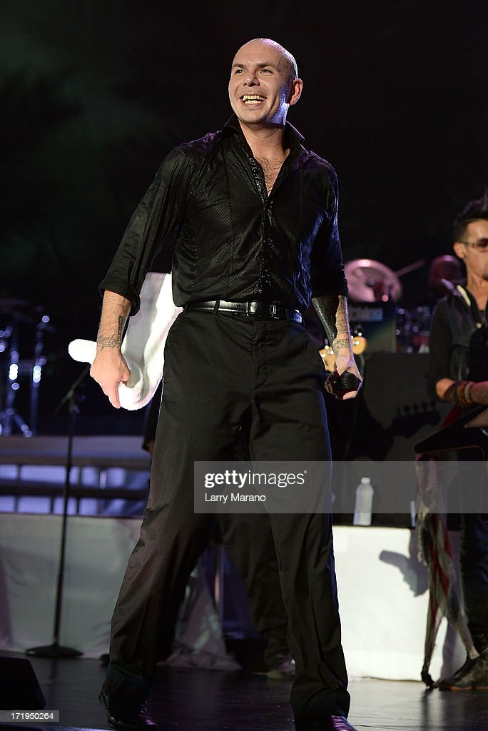 Pitbull performs live at the iHeartRadio Ultimate Pool Party Presented by VISIT FLORIDA at Fontainebleau's BleauLive in Miami on June 29, 2013 in Miami Beach, Florida.