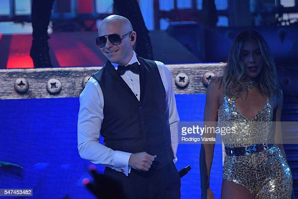 Pitbull performs onstage at the Univision's 13th Edition Of Premios Juventud Youth Awards at Bank United Center on July 14, 2016 in Miami, Florida.