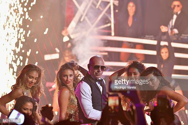 Pitbull performs onstage at the Univision's 13th Edition Of Premios Juventud Youth Awards at Bank United Center on July 14 2016 in Miami Florida