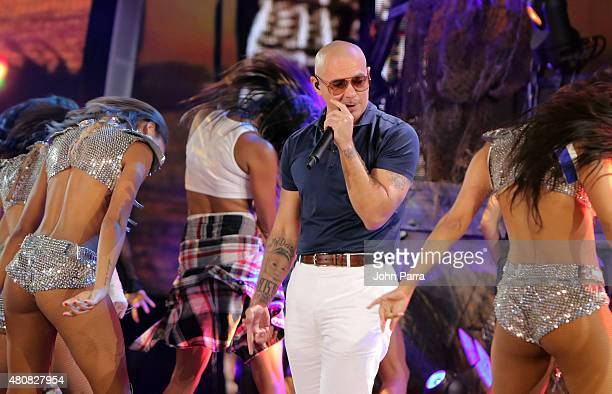 Pitbull performs onstage during Univision's Premios Juventud 2015 rehearsal at Bank United Center on July 15 2015 in Miami Florida