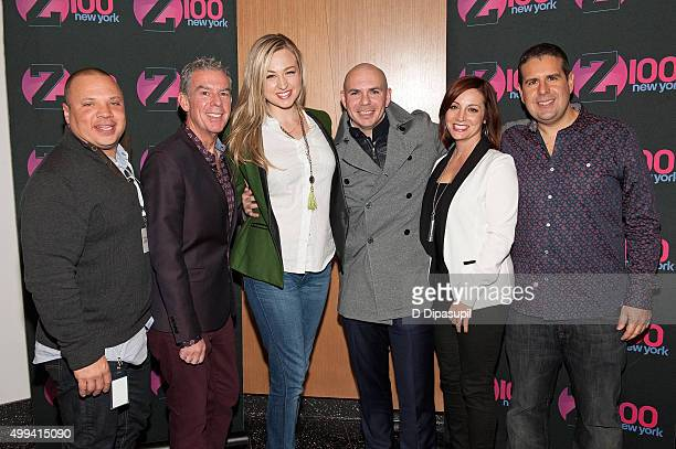 Pitbull poses with Greg T Elvis Duran Bethany Watson Danielle Monaro and Skeery Jones during his visit to The Elvis Duran Z100 Morning Show at One...