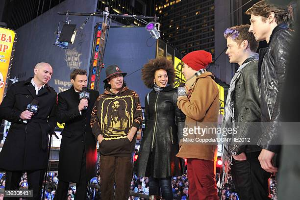 Pitbull Ryan Seacrest Carlos Santana Cindy Blackman Justin Bieber Nash Overstreet and Ryan Follese perform onstage during Dick Clark's New Year's...
