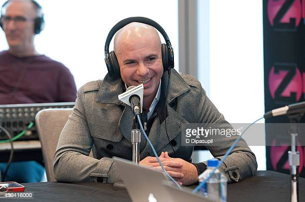 Pitbull visits The Elvis Duran Z100 Morning Show at One World Observatory on December 1 2015 in New York City