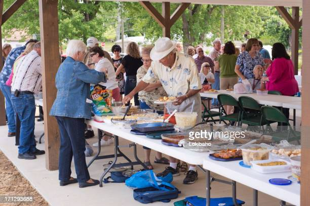 pitch in dinner at the picnic shelter - windbreak stock pictures, royalty-free photos & images