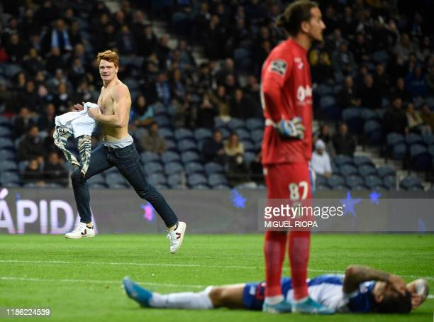 Pitch intruder runs on the field during the Portuguese league football match between FC Porto and FC Pacos de Ferreira at the Dragao stadium in Porto...
