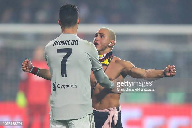 A pitch invader confronts Cristiano Ronaldo of Juventus during the Serie A match between US Sassuolo and Juventus at Mapei Stadium Citta' del...