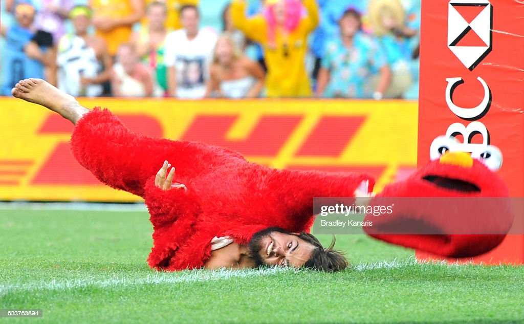 A pitch invader dressed as the Sesame Street character Elmo