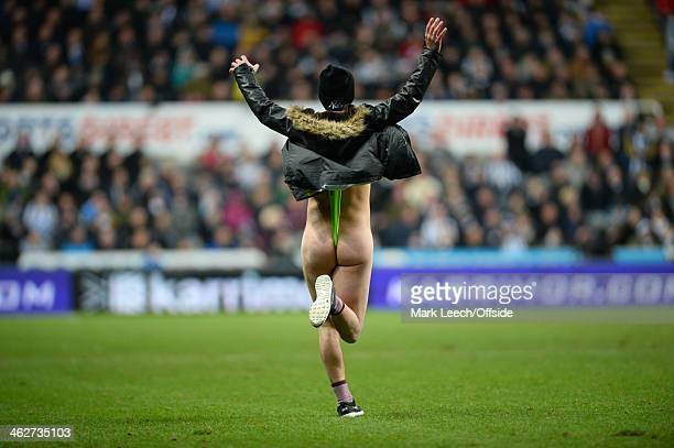 A pitch invader dressed in a Borat style mankini during the Barclays Premier League match between Newcastle United and Manchester City at St James'...