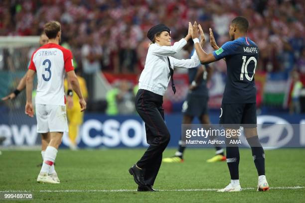 Pitch invader high five's Kylian Mbappe of France during the 2018 World Cup Final during the 2018 FIFA World Cup Russia Final between France and...