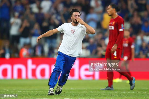 Pitch invader interrupts play during the UEFA Super Cup match between Liverpool and Chelsea at Vodafone Park on August 14, 2019 in Istanbul, Turkey.