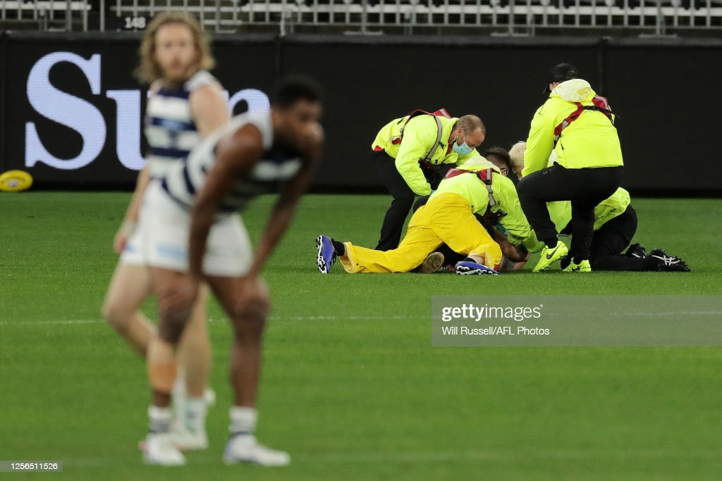 A Pitch Invader Is Apprehended By Security During The Round 7 Afl News Photo Getty Images