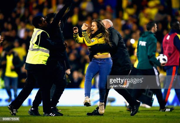 A pitch invader is carried away by a steward during the International friendly between Australia and Colombia at Craven Cottage on March 27 2018 in...