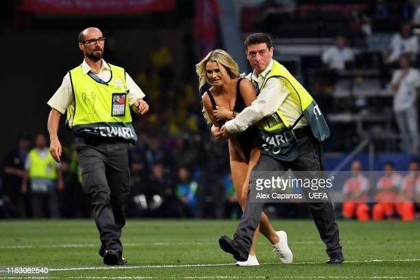 Pitch invader is caught after running onto the field during the UEFA Champions League Final between Tottenham Hotspur and Liverpool at Estadio Wanda...