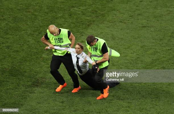 A pitch invader is dragged off the pitch during the 2018 FIFA World Cup Russia Final between France and Croatia at Luzhniki Stadium on July 15 2018...