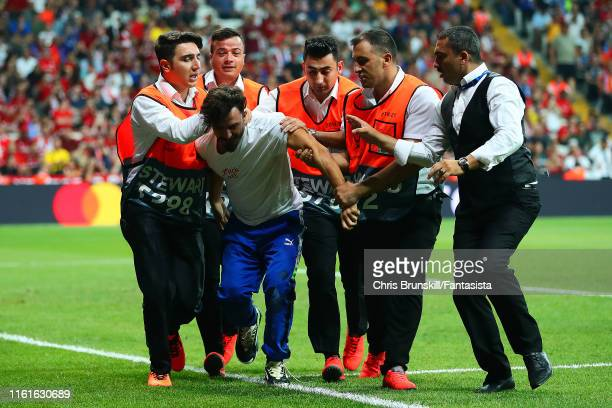 Pitch invader is removed during the UEFA Super Cup match between Liverpool and Chelsea at Vodafone Park on August 14, 2019 in Istanbul, Turkey.