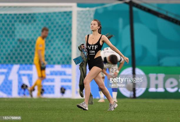 Pitch invader is seen on the pitch during the UEFA Euro 2020 Championship Group B match between Finland and Belgium at Saint Petersburg Stadium on...