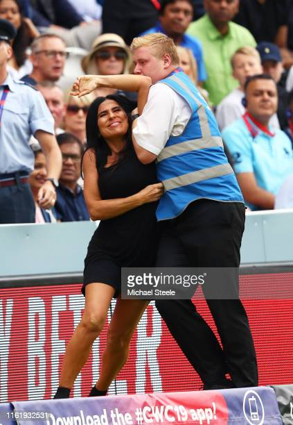 Pitch invader is tackled by stewards during the Final of the ICC Cricket World Cup 2019 between New Zealand and England at Lord's Cricket Ground on...