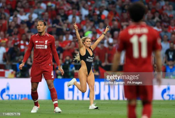 NUDITY* Pitch invader Kinsey Wolanski interrupts play during the UEFA Champions League Final at the Wanda Metropolitano Madrid