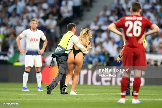 Pitch invader Kinsey Wolanski is caught after running onto the field during the UEFA Champions League Final between Tottenham Hotspur and Liverpool...